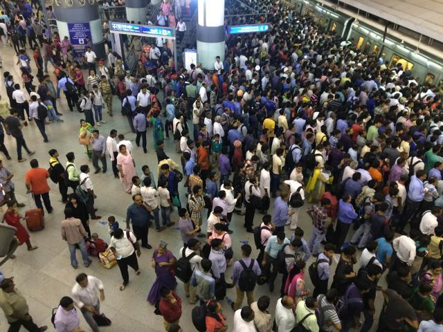 A long queue at Rajiv Chowk, one of the most crowded  metro stations.