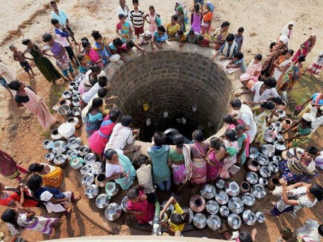 Villagers head towards a water hole atop a hill whose groundwater level has risen due to water harvesting, Rajsamand, Rajasthan.