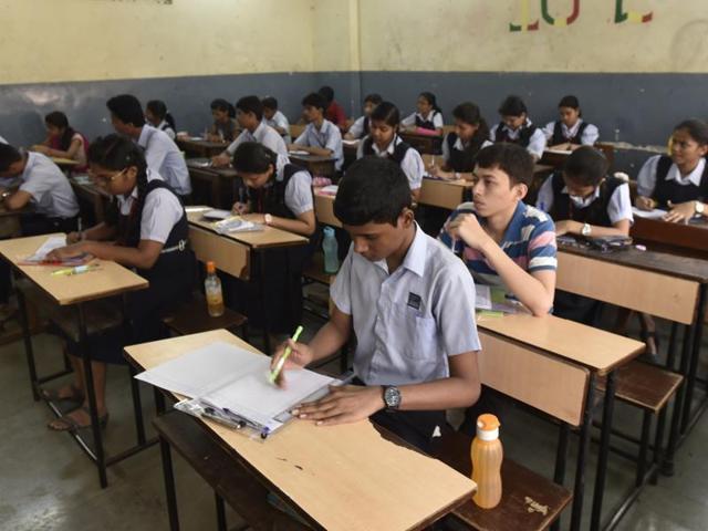 Children take a test in a Mumbai school.