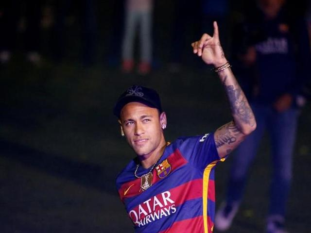 Barcelona's Neymar salutes the crowd during a ceremony celebrating the club's season at Camp Nou stadium in Barcelona, Spain.