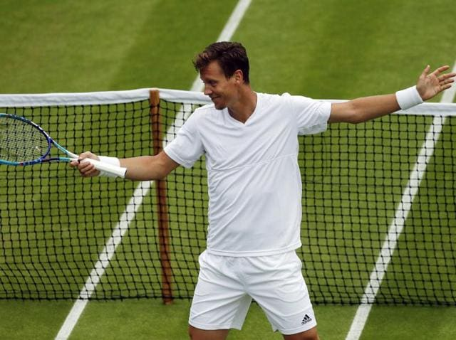 Tomas Berdych of the Czech Republic celebrates after beating Ivan Dodig of Croatia in their men's singles match on day three of the Wimbledon Tennis Championships in London.
