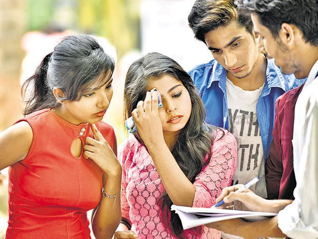 Students and parents at Delhi University in May 2015 search for the best courses to apply.