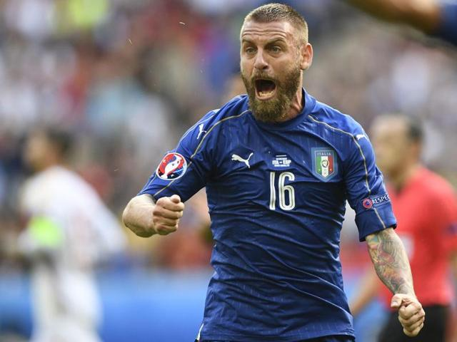Italy's midfielder Daniele De Rossi reacts during Euro 2016 round of 16 football match between Italy and Spain at the Stade de France stadium in Saint-Denis, near Paris.