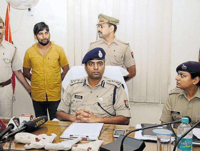 The accused (in yellow shirt) was arrested following a police raid in Shati Nagar Gate in Loni on late Monday night.
