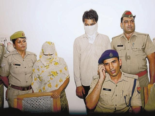 The accused in police custody.