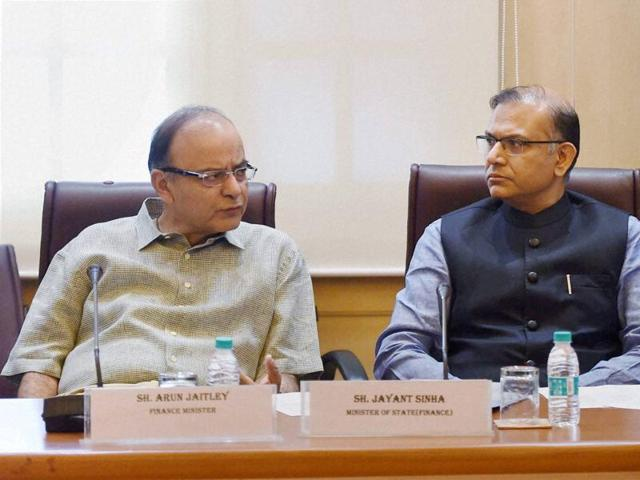 Union finance minister Arun Jaitley, MoS for Finance Jayant Sinha and Revenue Secretary Hasmukh Adhia during a meeting with chambers of commerce & association of professionals on income declaration scheme, in New Delhi on Tuesday.
