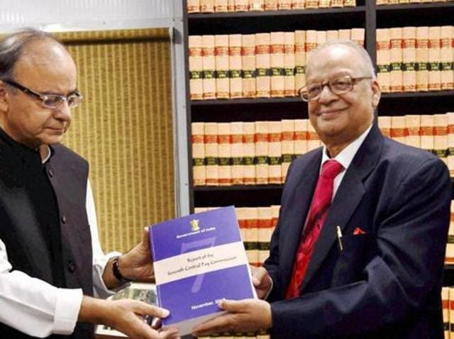 New Delhi: Finance Minister Arun Jaitley receiving the report of Seventh Pay Commission from its Chairman Justice A K Mathur. The Seventh Pay Commission has recommended One Rank, One Pension (OROP) for all civilian employees.
