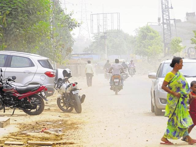 Residents allege that the authority started work without implementing precautionary measures to contain the dust.
