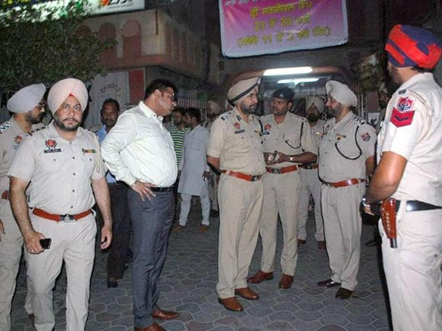 Amritsar Police investigating at a crime spot in the city.