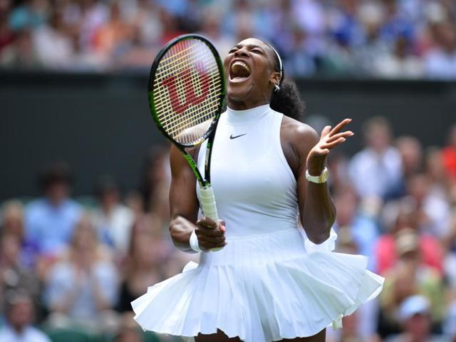 Serena Williams of the US plays a return to Amara Safikovic of Switzerland during their women's singles match on day two of the Wimbledon Tennis Championships in London.