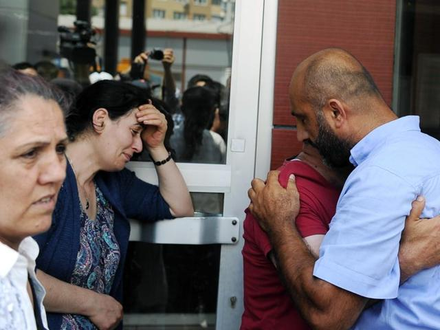 Family members of victims cry outside the Bakirkoy State Hospital in Istanbul.
