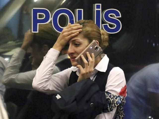 Turkish police officers stand outside Istanbul's Ataturk airport, late Tuesday, June 28, 2016. Two explosions rocked Istanbul's Ataturk airport, killing several people and wounding others, Turkey's justice minister and another official said Tuesday.