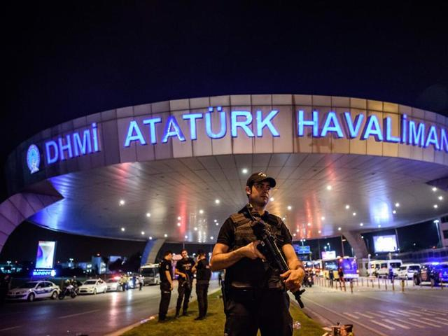 Passengers embrace each other at the entrance to Istanbul's Ataturk airport, following their evacuation after a blast, June 29, 2016
