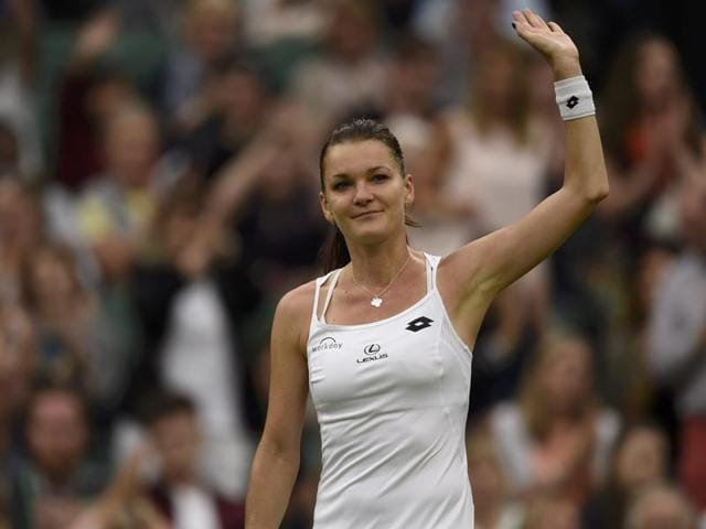 Agnieszka Radwanska of Poland (left) shakes hands with Kateryna Kozlova of the Ukraine after beating her in their women's singles match, on day three of the Wimbledon Tennis Championships in London.