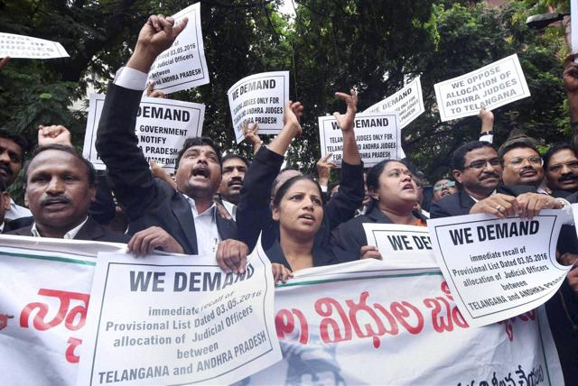 Telangana advocates holding placards at a protest in front of the High Court demanding separate high court for Telangana, in Hyderabad on Tuesday.