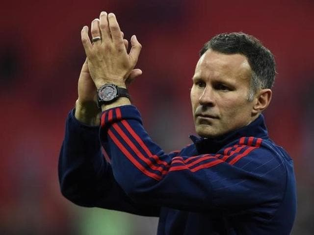 Manchester United's Welsh assistant manager Ryan Giggs joins the warm up before kick off of the English Premier League football match between Manchester United and Everton at Old Trafford in Manchester.