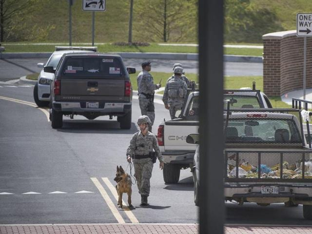 Security personnel patrol outside the Malcolm Grow Medical facility on Andrews AFB in Morningside, Md., when the base was placed on lockdown.
