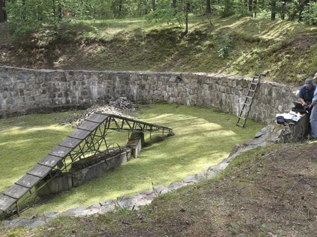 This photograph released by the Israel Antiquities Authority made on Wednesday shows preparation for Electric Resistivity Tomography scan of the pit used to hold the victims before their execution at Ponar massacre site near the town of Vilnius, Lithuania.(AP)