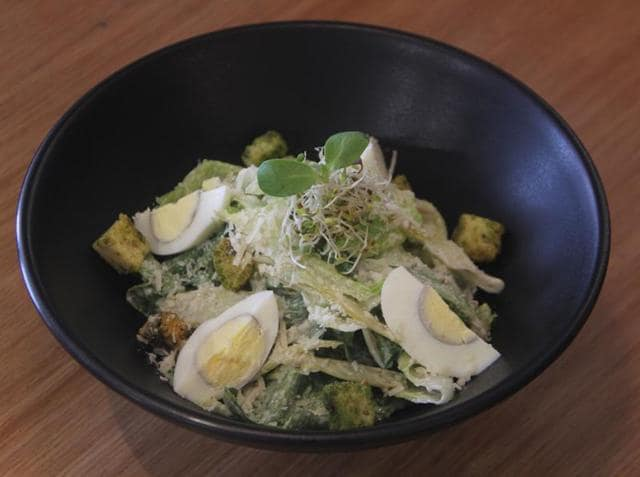 The portions at Ministry of Salads are generous enough that you can make a meal of your salad. The egg Caesar, the only non-vegetarian salad on the menu, is a heaped bowl of salad leaves, micro greens, crunchy croutons and quartered boiled eggs with a thick creamy dressing.