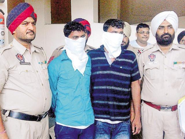 The two accused in police custodyat Rajpura on Thursday.