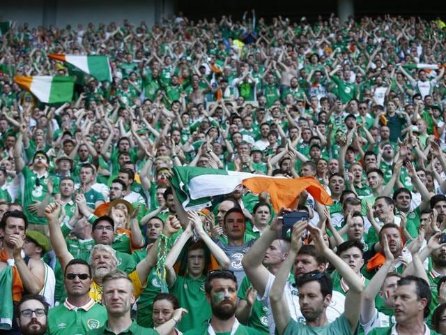 Irish fans salute the players at the end of the Euro 2016 round of 16 football match between France and Ireland, at the Grand Stade in Decines-Charpieu, near Lyon, France.