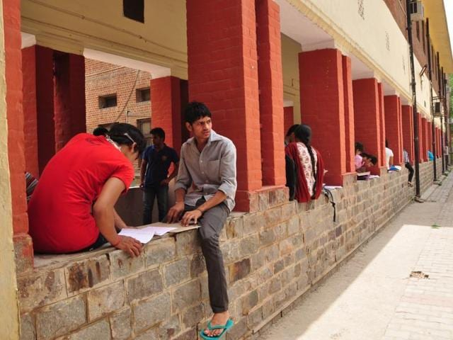 Students fill up admission forms in Khalsa College, one of the most aspired for in DU.