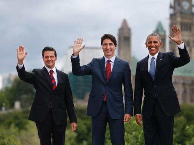 Mexican President Enrique Pena Nieto, Canadian Prime Minister Justin Trudeau and US President Barack Obama pose for a group photo with Canada's Parliament Hill in the background during the North American Leaders Summit on June 29, 2016 in Ottawa, Ontario.