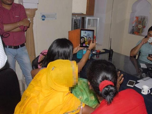This was one of the photos circulating on social media showing Soumya Gurjar (holding her phone) clicking a selfie with a rape victim (face blurred) and the chairperson of the Rajasthan Women's Commission.