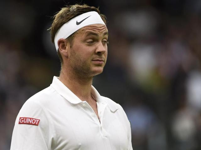Britain's Marcus Willis reacts after a point against Switzerland's Roger Federer in their men's singles second round match on the third day of the 2016 Wimbledon Championships at The All England Lawn Tennis Club in Wimbledon, southwest London.