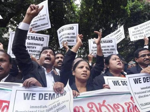 A file photo shows lawyers protesting outside the Andhra Pradesh high court premises to press for their demands.