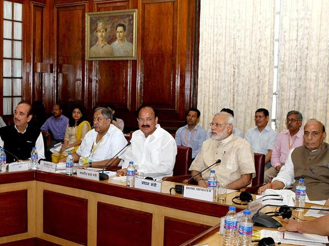 Prime Minister Narendra Modi with cabinet colleagues and opposition leaders at an all-party meeting.