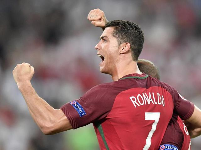 Portugal's Cristiano Ronaldo celebrates after winning the Euro 2016 quarterfinal football match between Poland and Portugal, at the Velodrome stadium in Marseille, France.