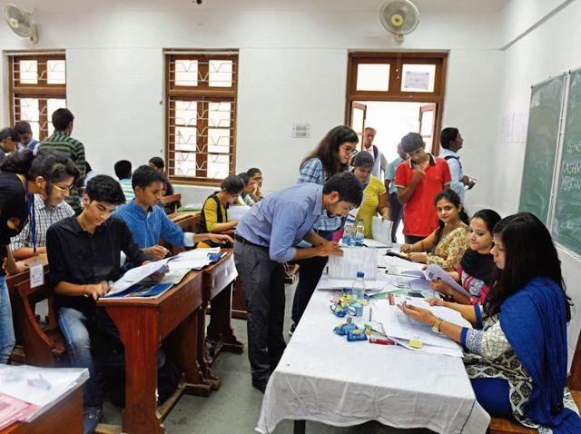 Students complete the admission formalities at Shri Ram College of Commerce on Thursday.
