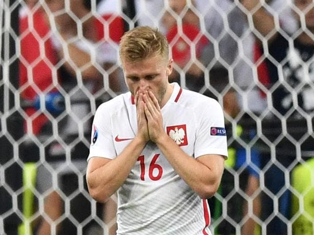 Poland midfielder Jakub Blaszczykowski reacts after missing a shot in a penalty shoot-out during the Euro 2016 quarterfinal football match between Poland and Portugal at the Stade Velodrome in Marseille.