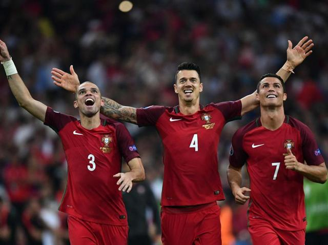 (From left) Portugal's defender Pepe, Portugal's defender Fonte and Portugal's forward Cristiano Ronaldo celebrate after winning the Euro 2016 quarterfinal football match between Poland and Portugal at the Stade Velodrome in Marseille.