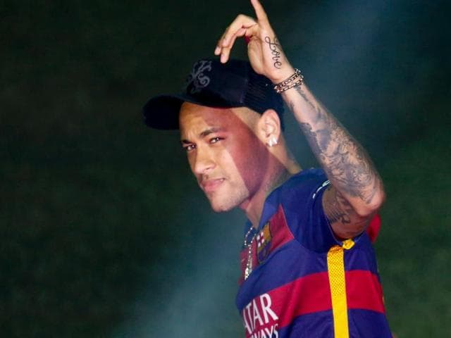 Barcelona's Brazilian forward Neymar acknowledges the crowd during celebrations at the Camp Nou stadium in Barcelona.