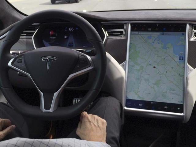A Tesla Model S with version 7.0 software update containing Autopilot features is seen during a Tesla event in Palo Alto, California.