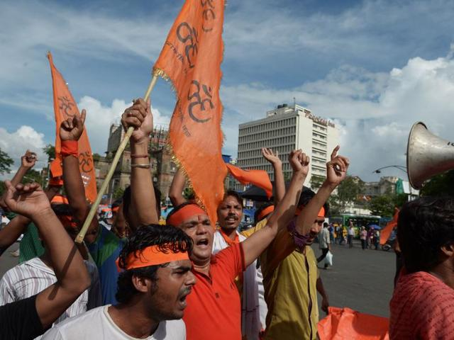 Activists of right wing religious organisations shout anti-Bangladesh government slogans during a protest rally in Kolkata on Thursday, to mark their protest against the recent killings of religious minorities, specially Hindus, in Bangladesh.