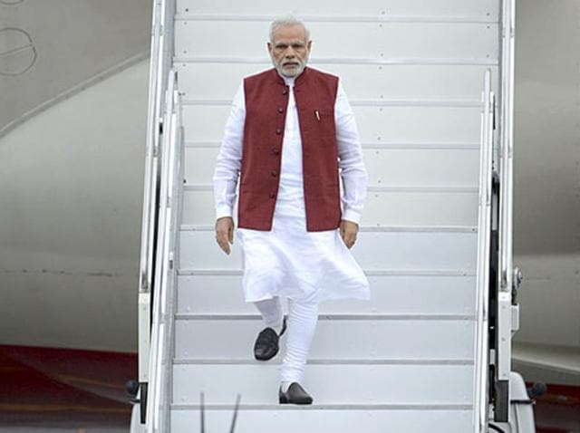 Prime Minister Narendra Modi disembarks a plane upon his arrival before attending the BRICS and the Shanghai Cooperation Organization (SCO) summits in Ufa, Russia. (Reuters)