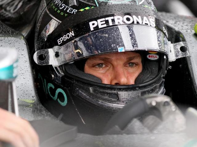 Mercedes driver Nico Rosberg of Germany gets a pit service during the second free practice session.