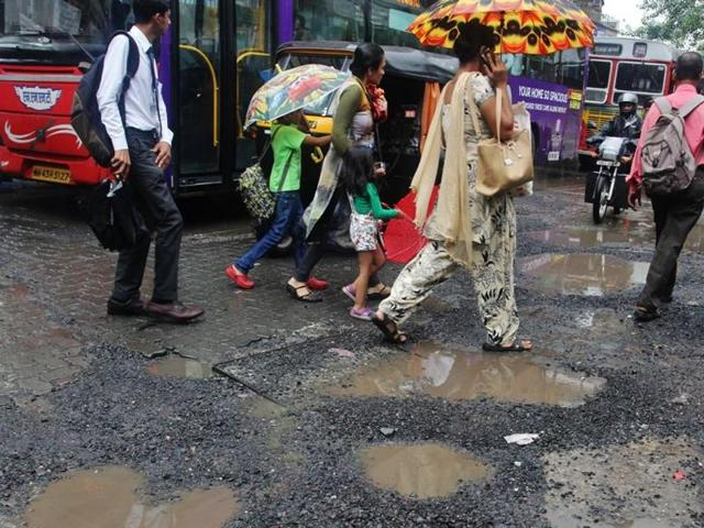 bhandup (w) Motorists and commuters struggle to cross the stretch of LBS Road, Bhandup.