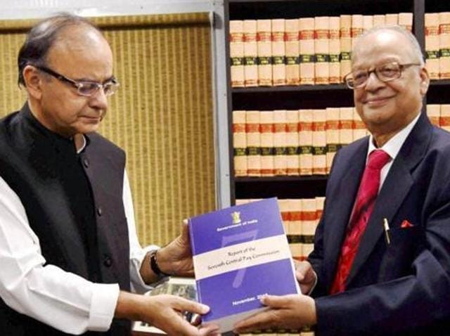 Finance minister Arun Jaitley receives the report of the Seventh Pay Commission from its chairman, justice A K Mathur in New Delhi on Thursday.