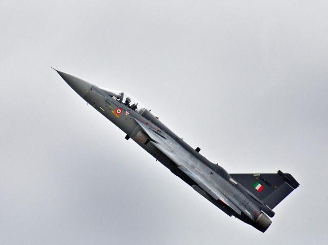 Light Combat Aircraft Tejas is displayed by Captain Madhav Rangachari, Commanding Officer of Flying Daggers during its induction ceremony, at HAL (ASTE) in Bengaluru.