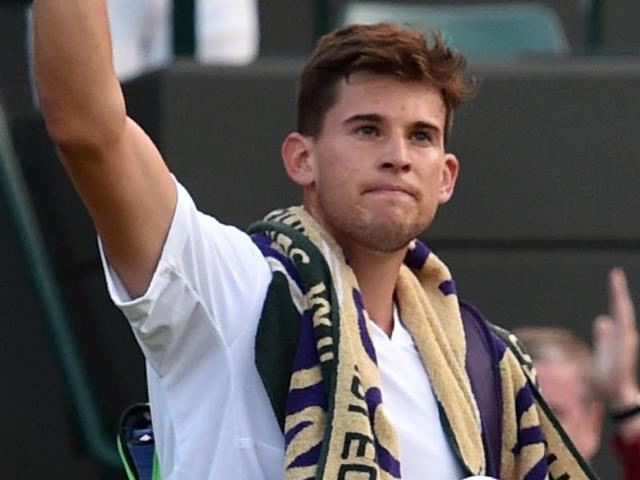 Austria's Dominic Thiem serves against Czech Republic's Jiri Vesely during their men's singles second round match on the fourth day of the 2016 Wimbledon Championships at The All England Lawn Tennis Club in Wimbledon, southwest London.