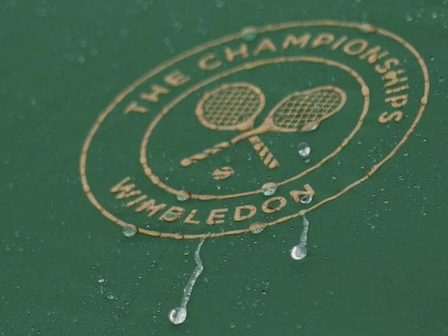 A general view of the Wimbledon logo in the rain.