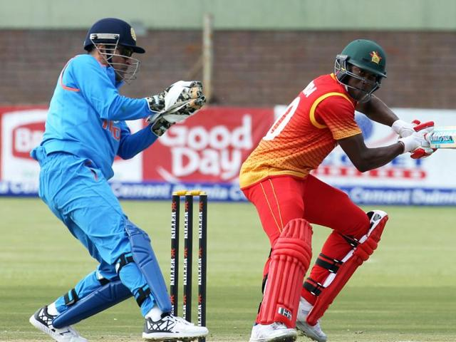 Indian wicketkeeper and captain MS Dhoni fields during the One Day International cricket match between Zimbabwe and India, at the Harare Sports Club.