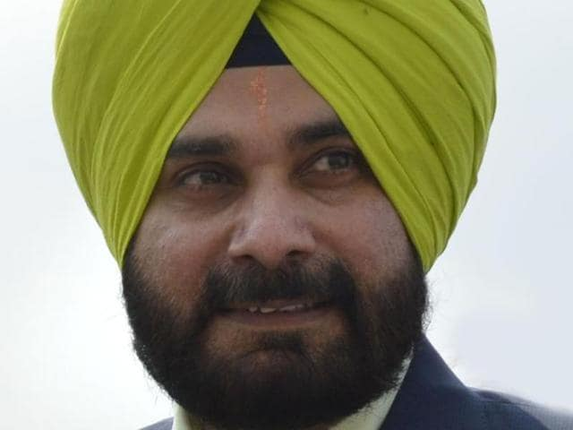 The Sidhu couple has been at loggerheads with chief minister Parkash Singh Badal, and his son and deputy Sukhbir Singh Badal, over alleged government bias against Amritsar which they see as an effort to erode their political standing.(HT Photo)