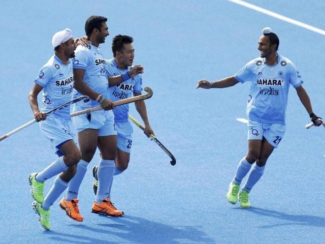 India's Raghunath Vokkaliga, second left, celebrates scoring their first goal.