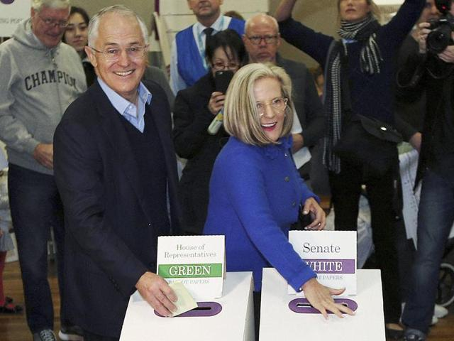 Australian Prime Minister Malcolm Turnbull and his wife Lucy cast their votes in the federal election at the Double Bay public school in Sydney.