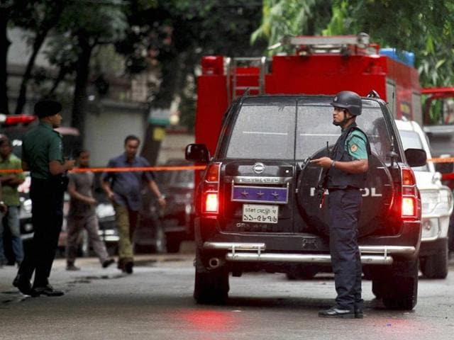 Bangladeshi security officers cordon off an area after heavily armed militants attacked a restaurant in Bangladesh's diplomatic zone on Friday night.